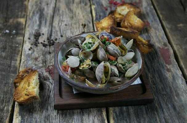 Roasted Clams with Sausage, Tomatoes and Fregola