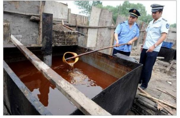 Police inspecting illegal cooking oil