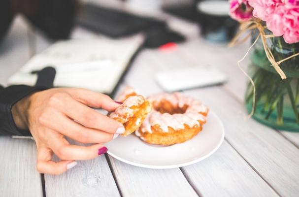 woman's hand holding donut