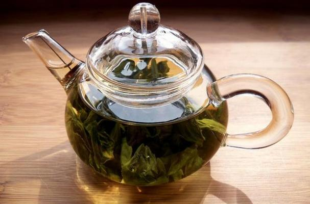 Green tea brewed in a teapot.