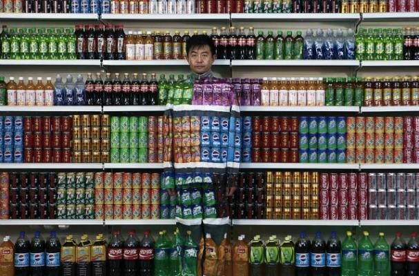 Chinese Artist Blends into Grocery Store Shelf for 'Plasticizer'