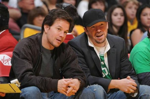 Donnie and Mark Wahlberg enjoy a basketball game together.