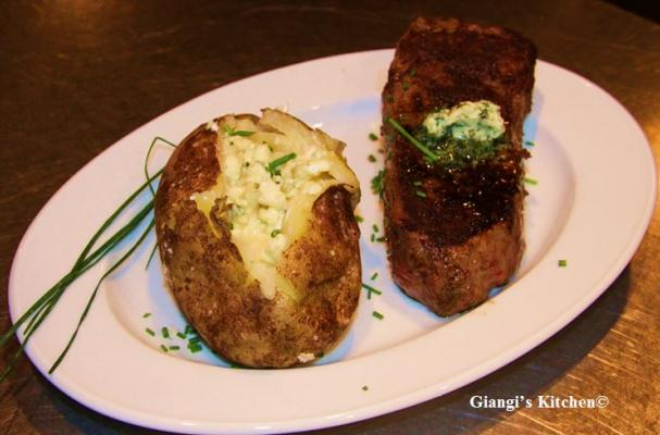 Steak with Baked Potatoes with Cheese and Butter